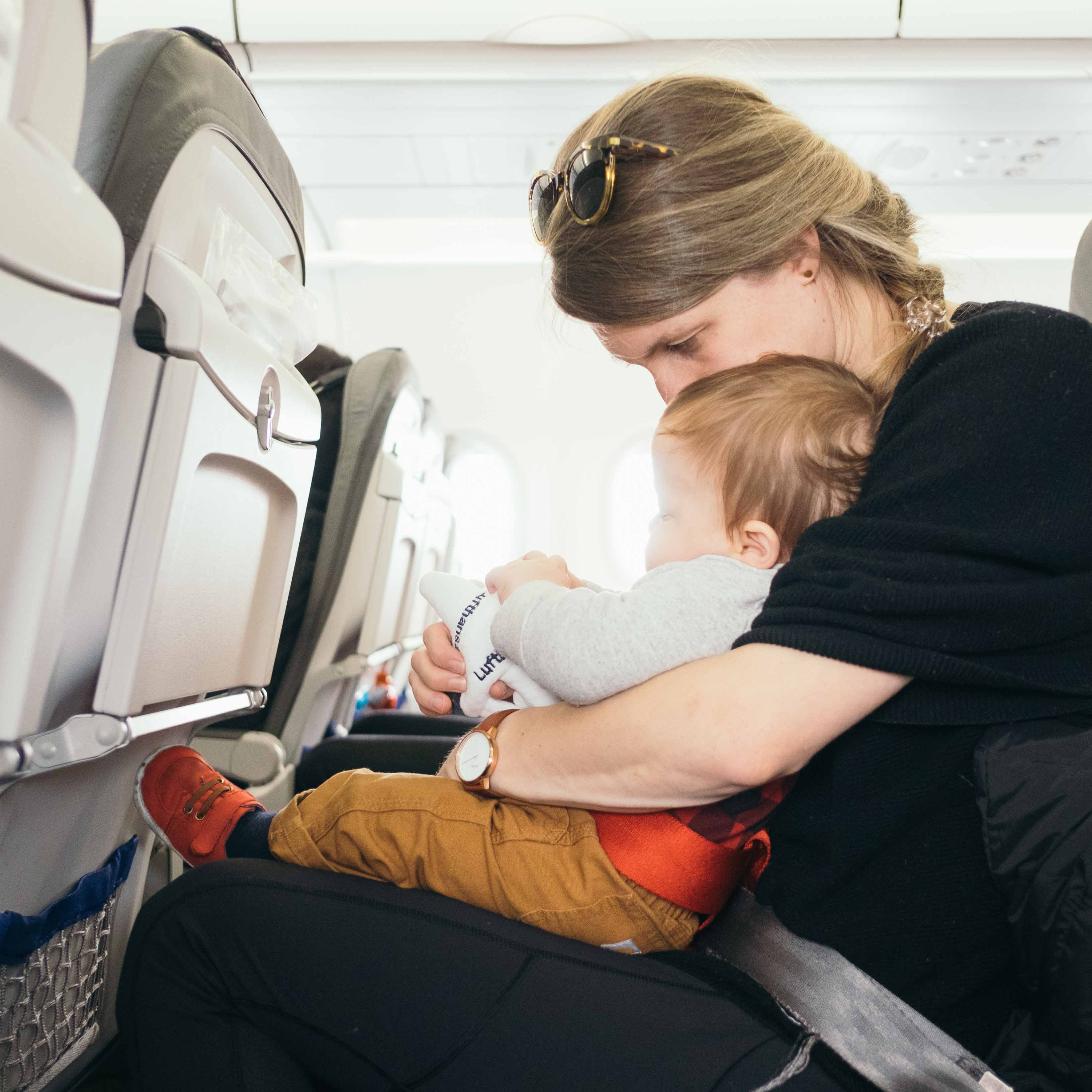 travelling with children: baby on a plane with mother